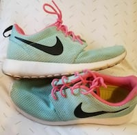 pair of green-white-and-pink Nike running shoes