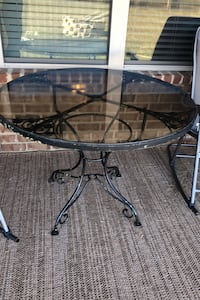 Iron rod table with glass top