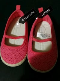 pair of pink Carter's crib shoes