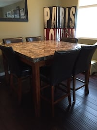 Dinning table with 6 leather chairs 54 by 54 inches stands 36 inches high Cambridge, N3C 4M4