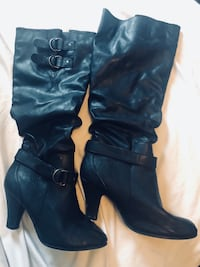 Pair of black leather knee high boots Lewiston, 83501