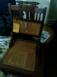 Antique chair with cane seat and back