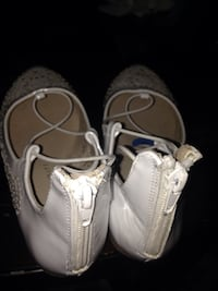 pair of white leather boat shoes Tacoma, 98444