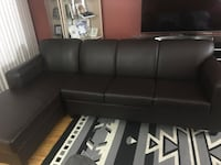black leather sectional sofa with throw pillows Toronto, M9M 1Y9
