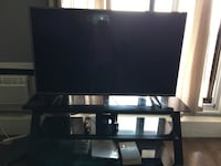 black flat screen TV with black TV stand Ottawa, K1V 7Y6