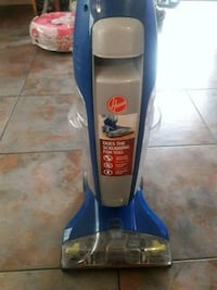 blue and gray Bissell upright vacuum cleaner