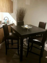 rectangular brown wooden table with four chairs dining set Edmonton, T5T 4K3