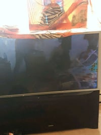 black flat screen TV with remote Edmonton, T5H 1M9