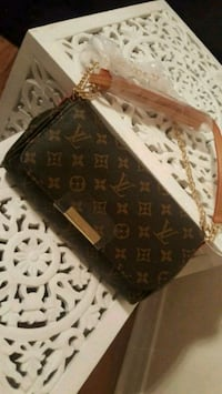 black and brown Louis Vuitton Monogram leather bag Laval, H7W