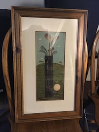 golf bag painting with brown wooden frame