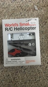 black and red R/C helicopter in box Ottawa, K1B 5K1
