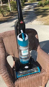 black and blue Bissell upright vacuum cleaner Fort Pierce, 34982