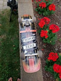 black and red skateboard with bindings Brossard, J4X 1X9