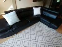 black leather sectional sofa with throw pillows Burnaby, V3N