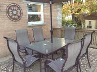 Rectangular metal patio table with chairs