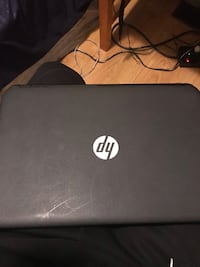 black HP laptop with AC adapter Brampton, L6X 0K9