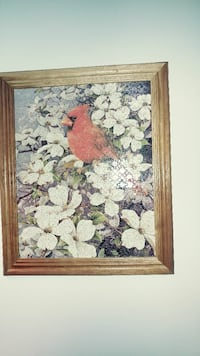 red bird perched on white flowers jigsaw puzzle painting with brown frame