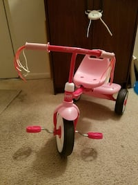 Toddler's pink and white Radio Flyer trike