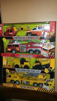 four assorted trucks toys with box