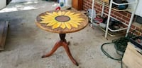 """Sunflower table 22"""" high 23"""" wide. Clayton, 27520"""