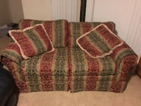 red and green floral fabric loveseat 749 mi