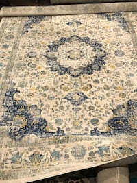 white, black, and brown floral area rug Mississauga