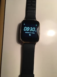 Smart watch for Android and Apple with Charger Golden Valley
