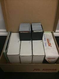 assorted Magic The Gathering trading card lot with boxes