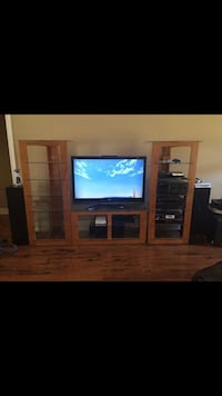BDI Entertainment Center. Solid wood with tempered glass shelves Brandon, 39042