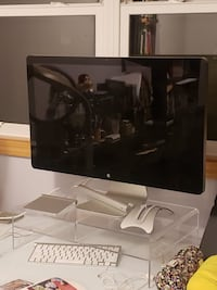 black flat screen TV with white wooden TV stand 2357 mi