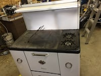 classic black and white and wood burning and gas range oven
