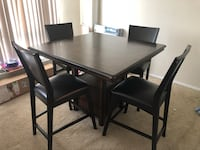 rectangular black wooden table with four chairs dining set Alexandria, 22305