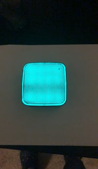 teal and white portable speaker 59 km