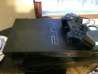 black Sony PS3 slim console with controller Springfield