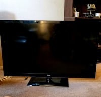 black flat screen TV with remote Tempe, 85281