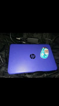 purple HP laptop with AC adapter  Floral City, 34436