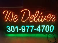 """Neon """"We Deliver"""" JanTec Sign w/Phone Number Potomac, 20854"""