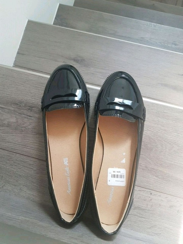 black-and-brown American Eagle loafers