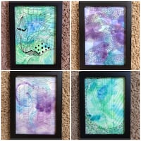 Four original paintings with black frames