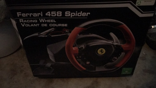 black and red Logitech steering wheel controller box