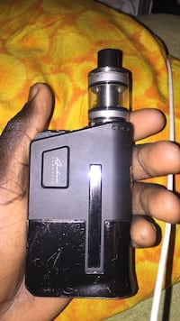 gray and black variable box mod with tank atomizer