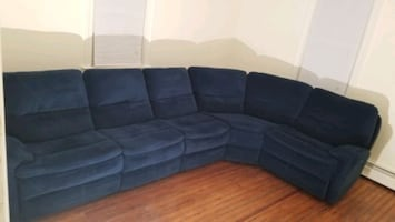 Reclining sectional sofa. Dual, powered recliner