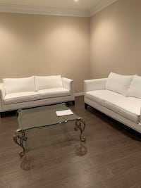 Two white fabric modern sofas with silver nail heads