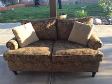 brown and white floral loveseat