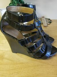 pair of black open-toe gladiator ankle strap leath