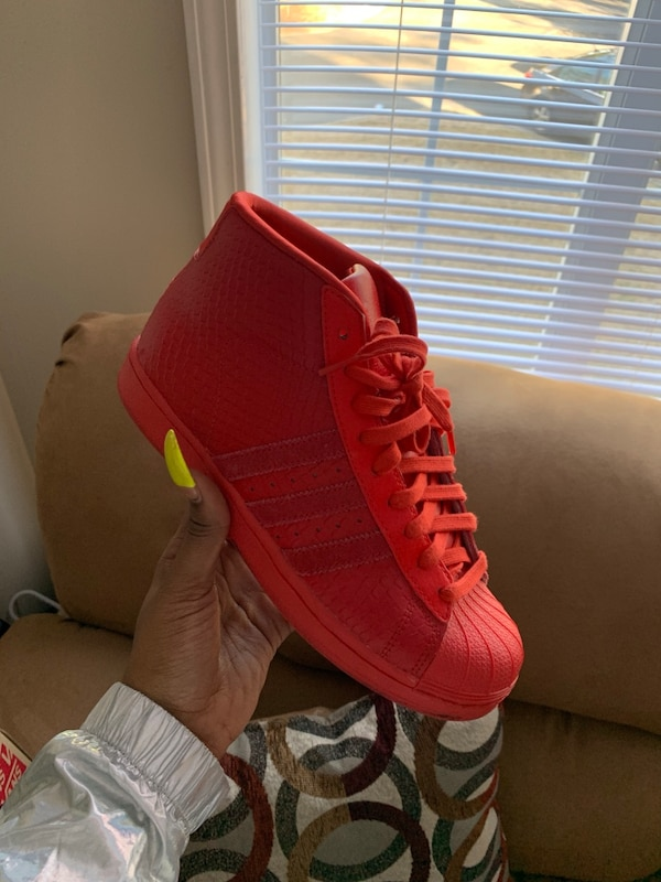 c6d9e19af9753 Used unpaired red and yellow Adidas low top sneaker for sale in Riverdale -  letgo