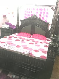 black wooden bed frame with pink and white floral bedspread Brampton, L6P 2G5