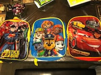 three Justice League, Paw Patrol, and Disney Cars backpacks