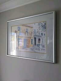 white wooden framed painting of house Waterloo