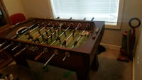 brown wooden foosball table with black metal base Airdrie, T4A 0T3